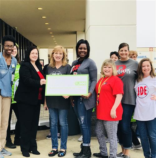 JDE Receives $1500 check from JoAnn Fabrics