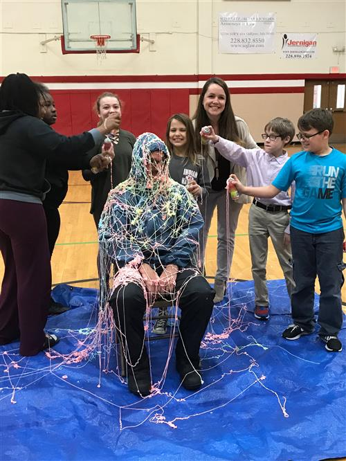 Mrs. Moran's Class earned the right to silly string Mr. Rolison