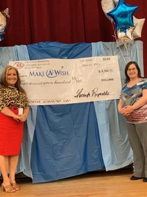BUE March of Dimes donation, Principal Kelleigh Reynolds